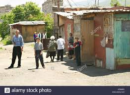 armenia vanadzor people outside houses made from shipping