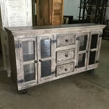 industrial buffet with glass doors and metal accents nadeau miami