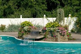 waterfalls for inground pools in ground pool featuring a vinyl liner hardscape fencing and