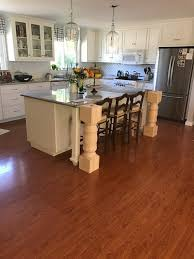 kitchen island with posts reddish brown laminate floor with traditional island with legs for