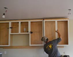 building kitchen cabinets how to hang kitchen cabinets at home and interior design ideas
