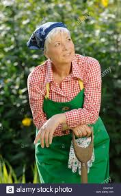 elderly woman clothes elderly woman gray haired 55 65 wearing gardening clothes and