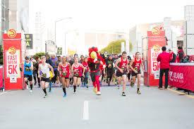 thanksgiving atlanta half marathon atlanta track club elite takes to the track and roads across the