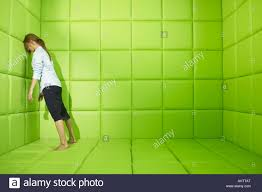 Padded Walls Pushing Against Walls Of Green Padded Cell Stock Photo