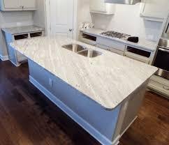 white kitchen cabinets with river white granite 25 white granite countertop colors for kitchen homenish
