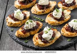 canapes aperitif canape crostini on slate board ideal stock photo 488609953