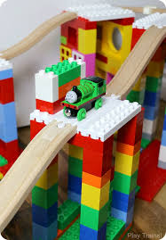 creative building play with duplo and wooden train tracks