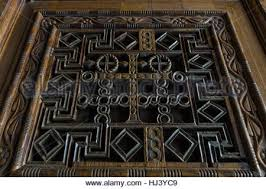 beautiful wood carving on ancient door in buddhist temple in kandy