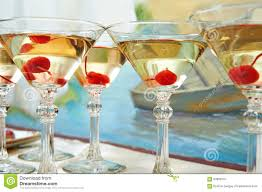 martini glasses and cherries on holiday party stock photo image