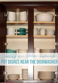 simple ways to organize kitchen cupboards clean mama simplify your kitchen cupboards put dishes near the dishwasher via clean mama