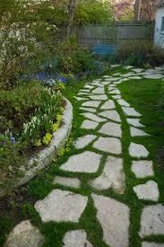 Backyard Walkway Ideas by Beautiful Yet Easy Maintenance With A Stone Mowable Walkway