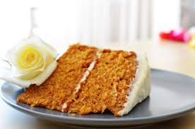 classic carrot cake with fluffy cream cheese frosting sprig and