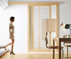 chic design of sliding interior doors made of solid wooden