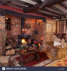 a wood burning stove in an oak framed building with log store
