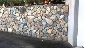 stone veneer over poured concrete wall youtube