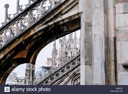 flying buttress and ornately carved stonework on the roof of the