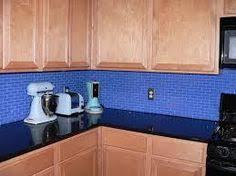A Custom Backsplash Designed To Match Cambrias Praa Sands Granite - Blue backsplash