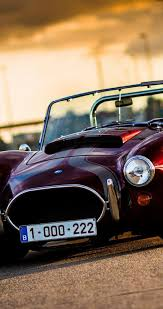 Old Classic Cars - old classic car small ac cobra on the road