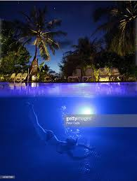 Pool At Night Woman Diving Into Swimming Pool At Night Stock Photo Getty Images