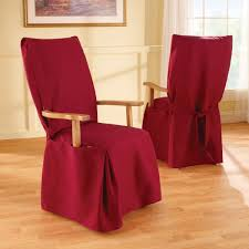 furniture dining room chair with red slipcover placed on wooden