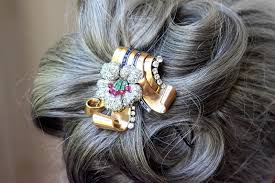 vintage brooches as hair ornament la chatelaine jewelry