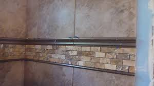mosaic accent tile tub surround natural stone brick wall accent