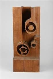 abstract carved wood sculpture titled eternal by