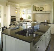second kitchen islands do you need a second sink examining the trend towards two sink
