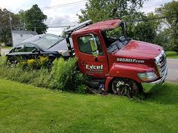 tow truck driver drives off road after suffering medical issue