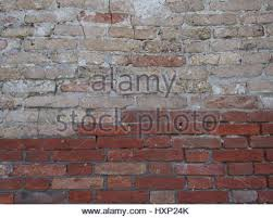 old red brick wall with fading painted sign stock photo royalty