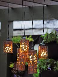 innovative outdoor hanging light fixtures design with fireplace