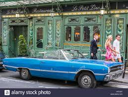 with vintage car in front of restaurant le petit zinc