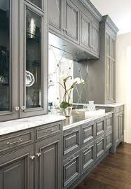 White And Gray Kitchen Features Gray Wash Cabinets Paired With - Gray kitchen cabinets
