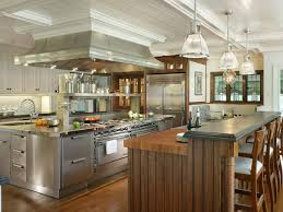 gourmet kitchen with large hood and large center island