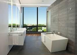 modern bathroom interior with white bathtub and floor to ceiling