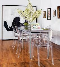 pretty narrow dining table with glass design have big flower vase