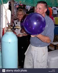 balloon helium tank blowing up balloon from helium tank stock photo 6224015 alamy