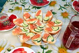sandwich with red fish salmon canape on buffet table stock photo