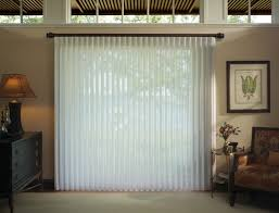 interior light brown panel vertical blinds mixed with green wall