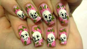 girly ed hardy inspired tattoo design with skulls and roses nail
