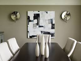 Dining Room With Abstract Wall Art And Mirrored Wall Sconces The - Wall sconces for dining room