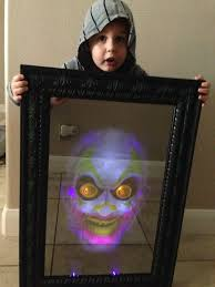 electrified maniac spirit halloween helping mom look for a place to hang the scary clown mirror we got