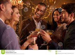 group of friends with drinks enjoying cocktail party stock photo