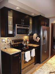 espresso cabinets with stainless steel appliances and backsplash kitchens
