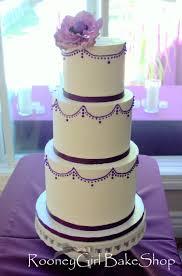 swiss meringue buttercream cake with purple piping gumpaste