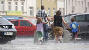 man and woman with three kids run in the rain without umbrellas