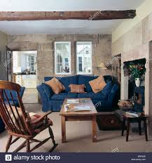 Living Room Blue Sofa by Windsor Chair And Wooden Coffee Table In Cottage Living Room With