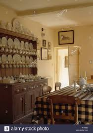 white crockery on antique pine dresser in country dining room with