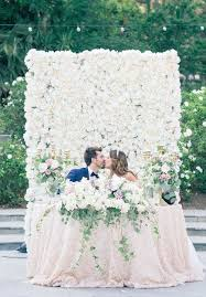 backdrop for wedding chic wedding with a lush floral wall backdrop ruffled