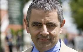 rowan atkinson mr bean star known for satire and love of fast